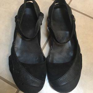 Black Teva shoes.